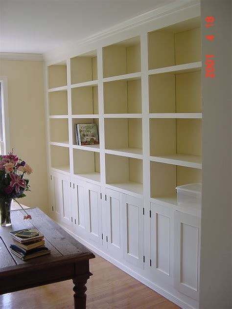 Floor to ceiling built ins, with bookshelves and cabinets