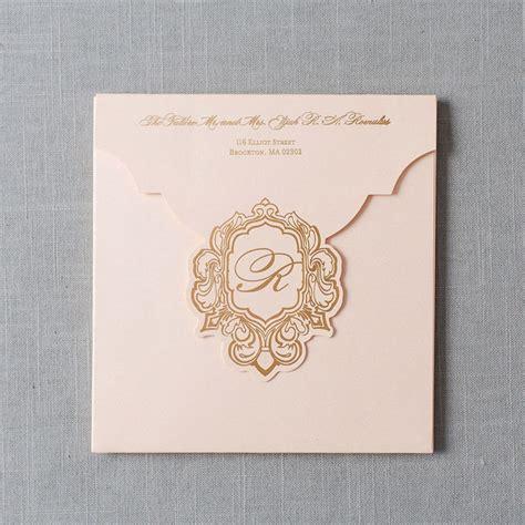 Elegant blush and gold foil folio invitation for the most