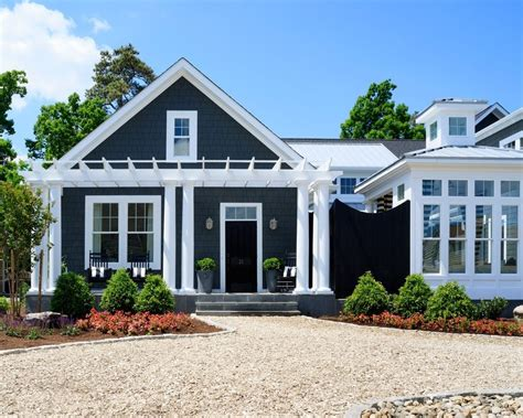 blue siding exterior traditional with crushed wooden front doors