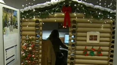 woman transforms cubicle  holiday themed log cabin