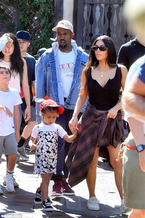 Kim Kardashian is caught eating churros at Disneyland | Daily Mail Online