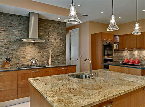 granite counter sles light maple kitchen cabinets