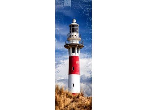 bild mit leuchtturm  strand  ungewoehnlichem design