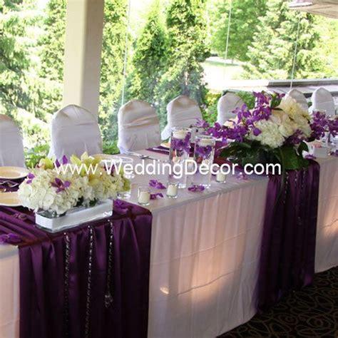 wedding decor head table white linens purple runners