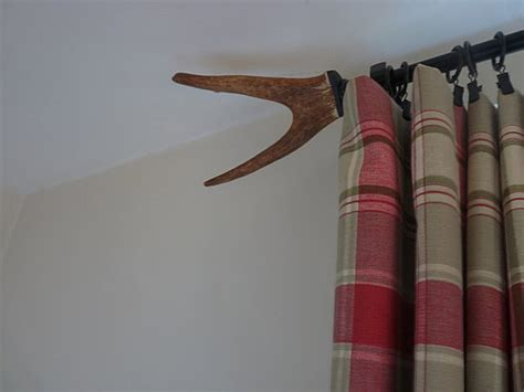curtain rod finial and tiebacks made from antlers