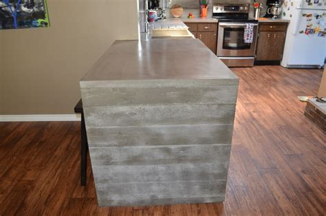 Waterfall concrete countertop finished by Mode Concrete