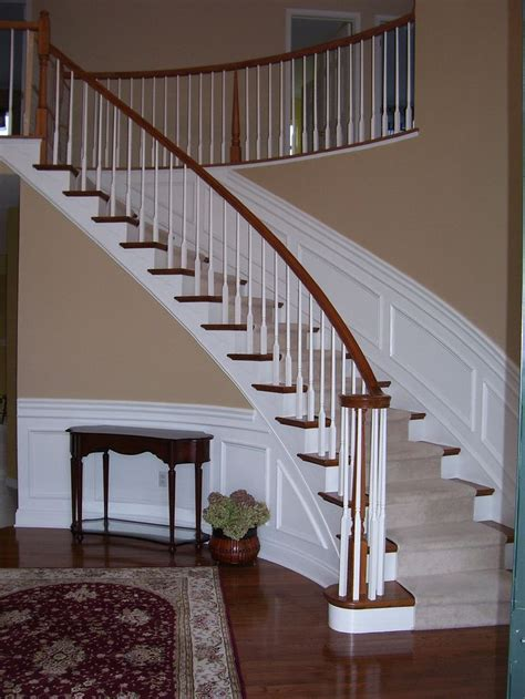 wainscoting  curved stairs wainscotting design