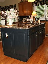 Black Kitchen Island with Oak Cabinets