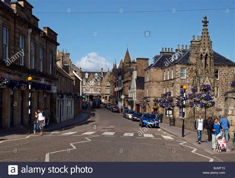 Changes of mitochondrial ultrastructure and function during ageing in mice and drosophila. high street view in Tain, Scotland Stock Photo - Alamy
