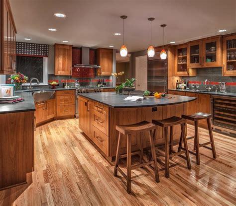dark oak floors kitchen craftsman  wood cabinets metal