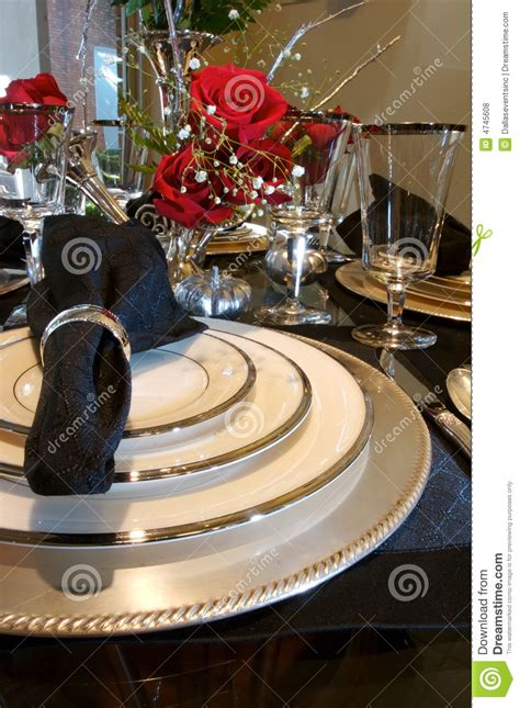 Fancy Chair by Formal Dining Room Place Setting Royalty Free Stock Photos