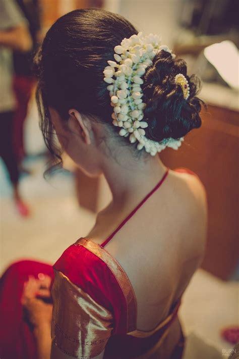 indian wedding hair styles mogra flowers encase bridal bun in a traditional style 1550