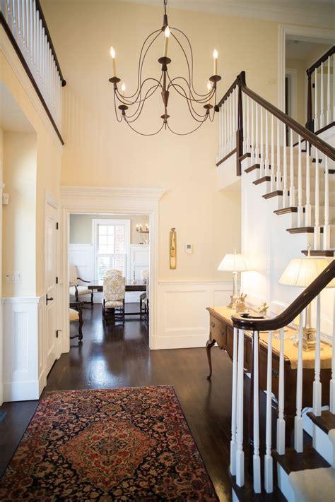 elegant entryway  lofted ceilings open stairway dark