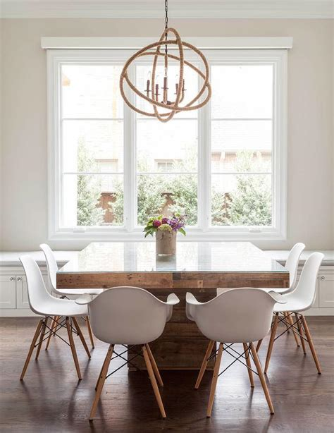 contemporary dining room features a rope sphere chandelier