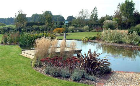 pond landscape design easy landscape for a large pond large pond and plantings my style pinterest pond