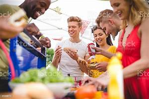 Friends Having Fun At A Bbq Stock Photo - Download Image Now - iStock