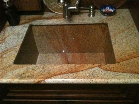 crafted granite sink by ellison tile and