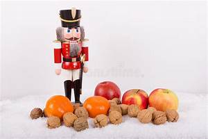 Nutcracker With Nuts, Tangerines At Christmas Time Stock Photo - Image: 35022642