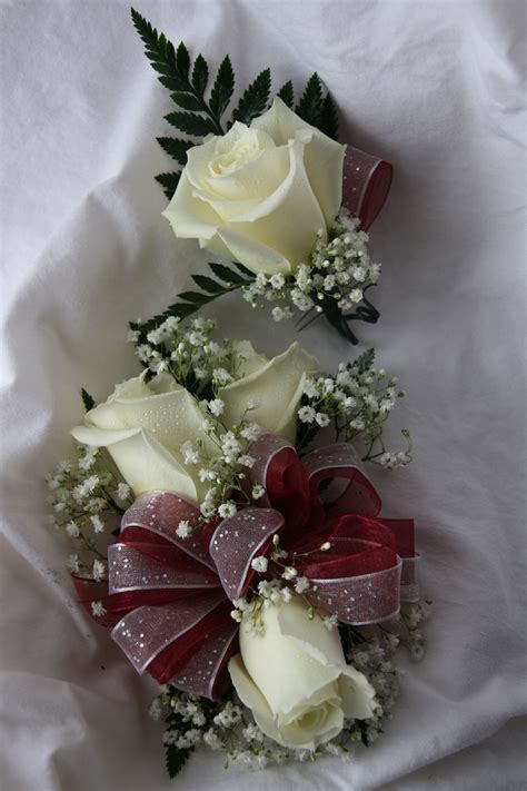 burgundy corsage  boutonniere flowers