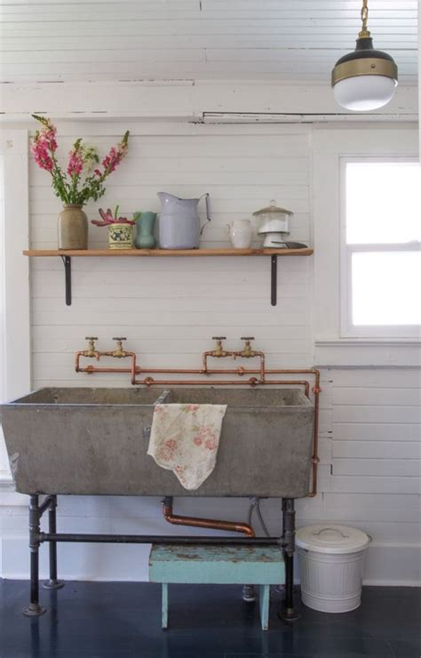 exposed kitchen sink a vintage concrete laundry sink in the laundry room 3629