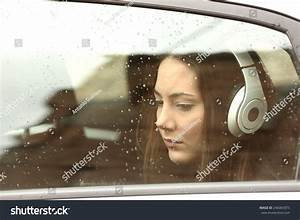 Sad Teenager Girl Inside Car Headphones Stock Photo ...