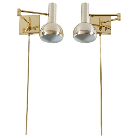 isaac sconce brass long arm modern swing arm wall lamps