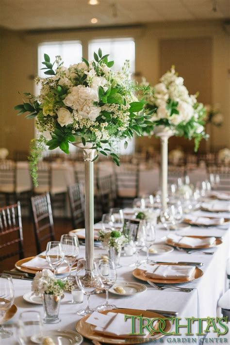 centerpieces for tables tall elegant table centerpieces that have white wax flower white roses white hydrangea