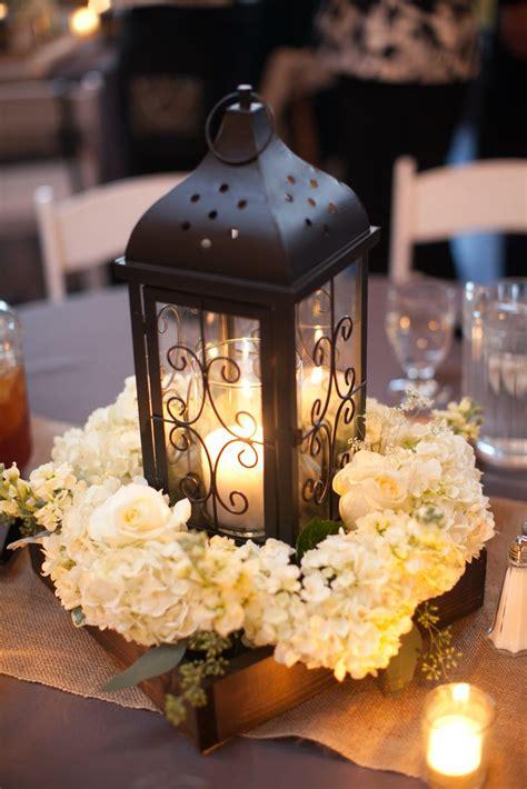 lantern for wedding centerpiece black lantern and white hydrangea centerpiece