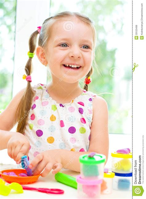 Child Playing With Play Dough Royalty Free Stock Images