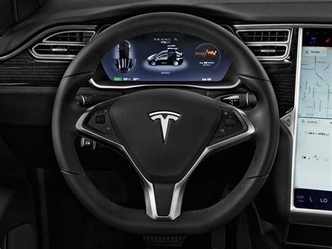 image  tesla model  awd  door  steering wheel