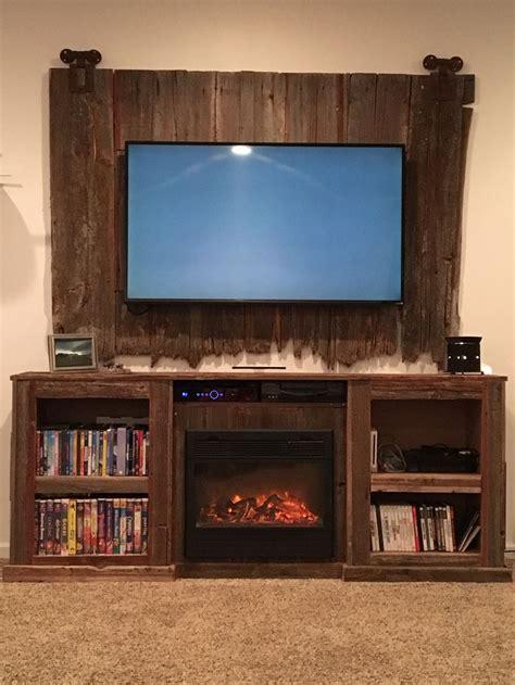 barn wood entertainment center  fire place insert tv