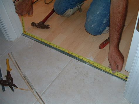 Cutting Laminate Flooring Trim, Installing The Transition