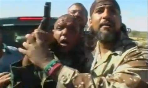 man  shot muammar gaddafi