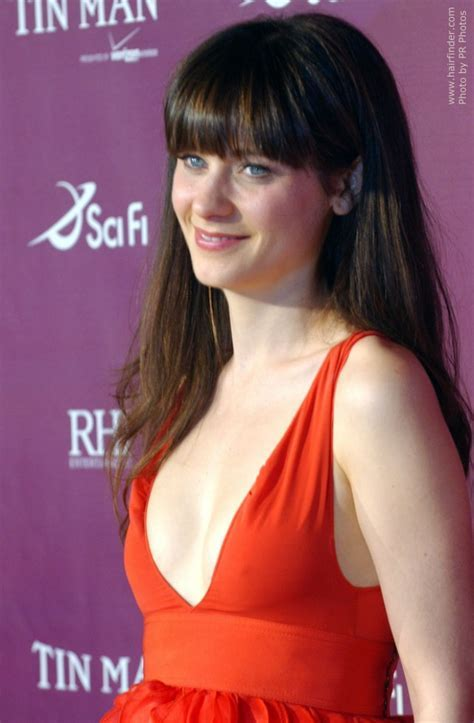 Zooey Deschanel wearing her thick mid back hair sleek with