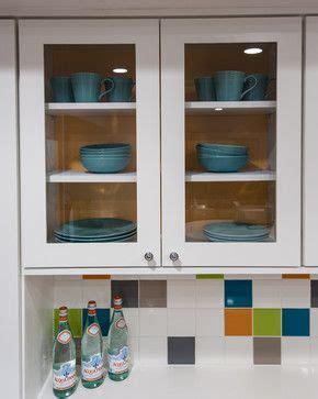 lights in the kitchen featured here our milan door in paint grade greige 7076
