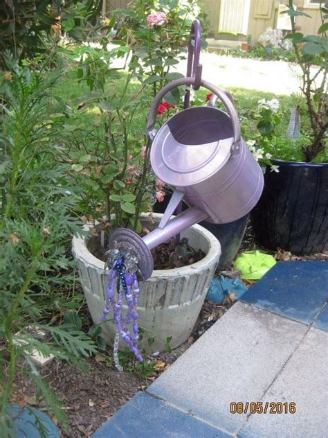 Gorgeous Garden Art From Old Watering Can Crafts