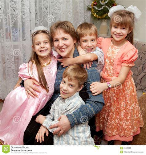 children hugging mother family concept stock photo