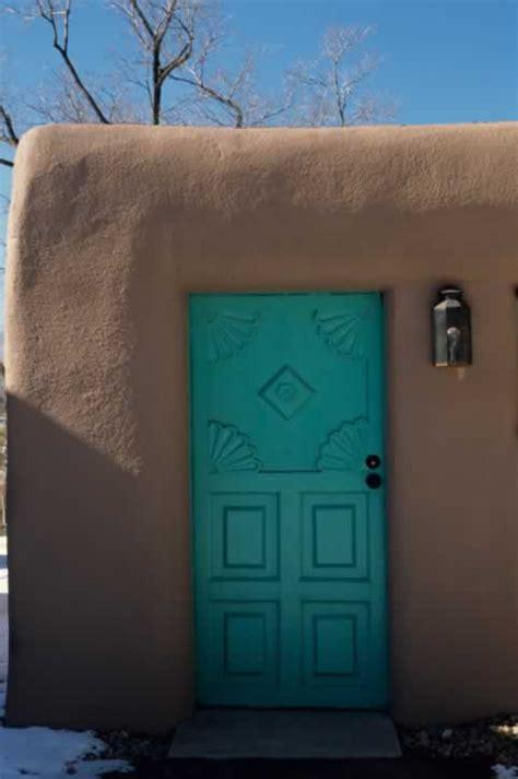 turquoise exterior panel door  carved fan design  southwest style adobe home door  window