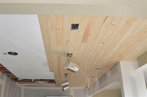 Above Kitchen Cabinets Ideas - diy how to install a wood planked ceiling house updated