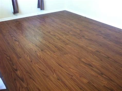 vinyl plank flooring or bad not bad but a little boring trafficmaster allure 6 in x 36 in teak resilient vinyl plank