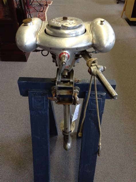 Old Boat Motors by Vintage Outboard Boat Motor Called The Water Witch By