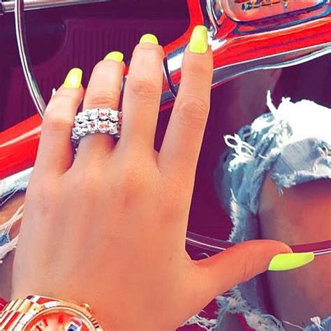 Khloe Kardashian Yellow Nails | Steal Her Style