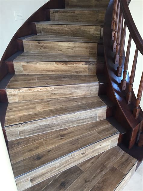wood  tile  newly stained banister porcelain