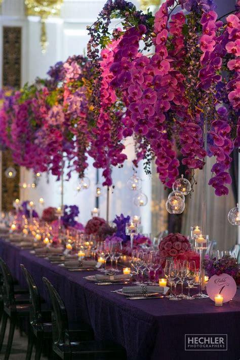 purple orchid wedding centerpieces   puff