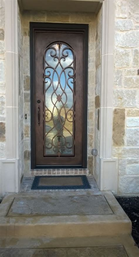 single custom wrought iron   flowing  unique scroll work wrought iron doors