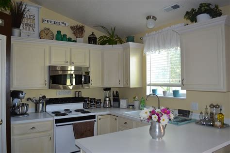 space above kitchen cabinets ideas ideas on how to decorate on the space above the cabinets