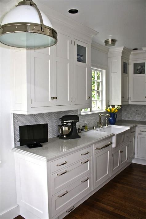 These white shaker cabinets come in a bright white, or creamy antique white—both shades complementing many colors, whether warm or cool if you like the modern look, pair white shaker cabinets with a glossy countertop and a dark contrasting flooring or different tones of silver and gray. Toe Kick Drawer - Transitional - kitchen - William Adams ...