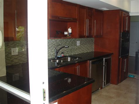 cherry wood cabinets with granite countertop coral springs kitchen remodeling by able quality