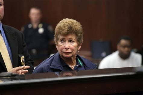 Tennis ref once accused of killing husband sobs in court ...
