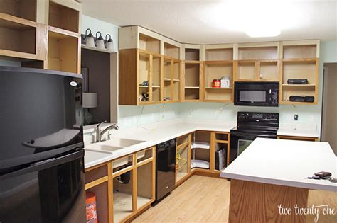 adding cabinets above kitchen cabinets kitchen reno the next step from thrifty decor 7403